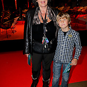 NLD/Amsterdam/20111012 - Premiere Patatje Oorlog, Willeke van Ammelrooy en kleinkind Jesse