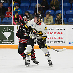 "TRENTON, ON  - MAY 5,  2017: Canadian Junior Hockey League, Central Canadian Jr. ""A"" Championship. The Dudley Hewitt Cup. Game 7 between Georgetown Raiders and the Powassan Voodoos. Jordan Crocker #9 of the Georgetown Raiders battles for control with Cameron Moore #4 of the Powassan Voodoos during the third period.  <br /> (Photo by Andy Corneau / OJHL Images)"
