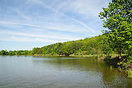Brilliant blue skies and lush green landscape of Tioga-Hammond Lakes in May.