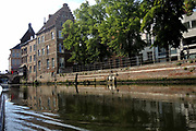 "Mechelen is a city and municipality in the province of Antwerp, Flanders, Belgium.<br /> <br /> On the Photo:  The Dijle flows through the city, hence it is often referred to as the Dijlestad (""City on the river Dijle"")."