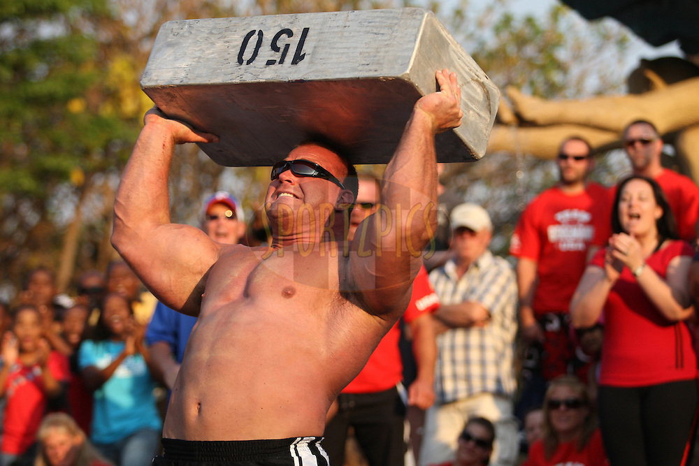 Derek Poundstone (USA) rests the 150kg metal block on his head for a second before attempting the competition record for the overhead lift during one of the qualifying rounds of the World's Strongest Man competition held in Sun City, South Africa.