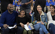 Los Angeles Lakers former guard Kobe Bryant (left) watches with his daughter Gianna Maria-Onore Bryant, wife Vanessa Bryant and daughter Natalia Diamante Bryant during an NCAA women's basketball game between the Connecticut Huskies and the UCLA Bruins in Los Angeles on Tuesday, Nov. 21, 2017. UConn defeated UCLA 78-60.