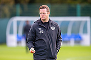 Heart of Midlothian coach Jon Daly watches the players train ahead of the Betfred Cup quarter-final match against Aberdeen, at Oriam Sports Performance Centre, Heriot Watt University, Edinburgh Scotland on 24 September 2019. Picture by Malcolm Mackenzie