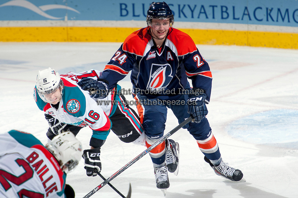 KELOWNA, CANADA -FEBRUARY 1: Ryan Rehill D #24 of the Kamloops Blazers checks Kris Schmidli #16 of the Kelowna Rockets on February 1, 2014 at Prospera Place in Kelowna, British Columbia, Canada.   (Photo by Marissa Baecker/Getty Images)  *** Local Caption *** Ryan Rehill; Kris Schmidli;