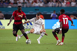 July 31, 2018 - Miami Gardens, Florida, USA - Manchester United F.C. defender Eric Bailly (3) (left) steels the ball from Real Madrid C.F. forward Borja Mayoral (21) (center) as Manchester United F.C. midfielder Fred (17) (right) looks at the action during an International Champions Cup match between Real Madrid C.F. and Manchester United F.C. at the Hard Rock Stadium in Miami Gardens, Florida. Manchester United F.C. won the game 2-1. (Credit Image: © Mario Houben via ZUMA Wire)