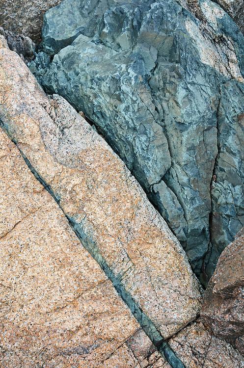 Basalt dyke cutting through pink Cadillac Mountain granite near Seal Harbor, Maine.