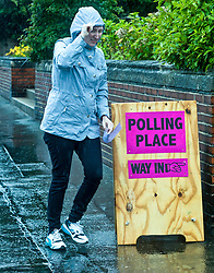 Voters are turning out in lower numbers than the 2015 General Election due to the heavy rain that has been falling on Scotland since the polls opened this morning.<br /> <br /> Pictured: Voters leaving the Polling Place at Wilson Memorial United Free Church of Scotland in Edinburgh