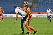 Bolton Wanderers Midfielder, Will Buckley (11) and Hull City Defender, Michael Dawson (21)  during the EFL Sky Bet Championship match between Bolton Wanderers and Hull City at the Macron Stadium, Bolton, England on 1 January 2018. Photo by Mark Pollitt.