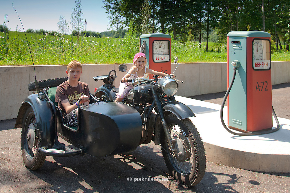 Kids in Old Sidecar Motorcycle in Gas Station, Estonian Road Museum, Põlva County