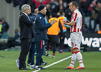 Football - 2016 / 2017 Premier League - West Ham United vs. Stoke City<br /> <br /> Charlie Adam of Stoke City talks to the Stoke Manager Mark Hughes and his staff during a pause in the game at The London Stadium.<br /> <br /> COLORSPORT/DANIEL BEARHAM