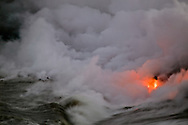 Flowing lava into ocean, creating steam cloud, Kilauea Volcano, Big Island, Hawaii