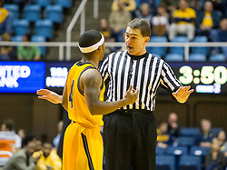 Dec 5, 2015; Morgantown, WV, USA; Kennesaw State Owls guard Yonel Brown (4) speaks with an official during the second half against the West Virginia Mountaineers at WVU Coliseum. Mandatory Credit: Ben Queen-USA TODAY Sports