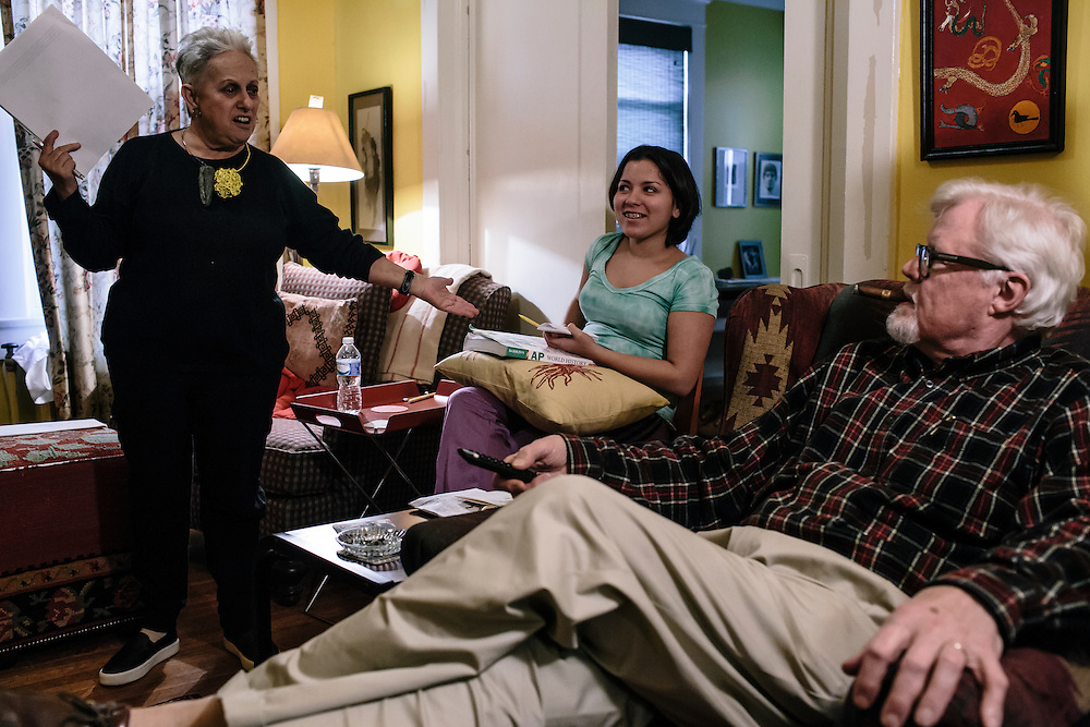After editing with her god-parents, Daniela Shia-Sevilla, 15, goes straight into completing homework while she watches the movie Badlands with her godparents Hank Leland and Bobbie Spalter-Roth.