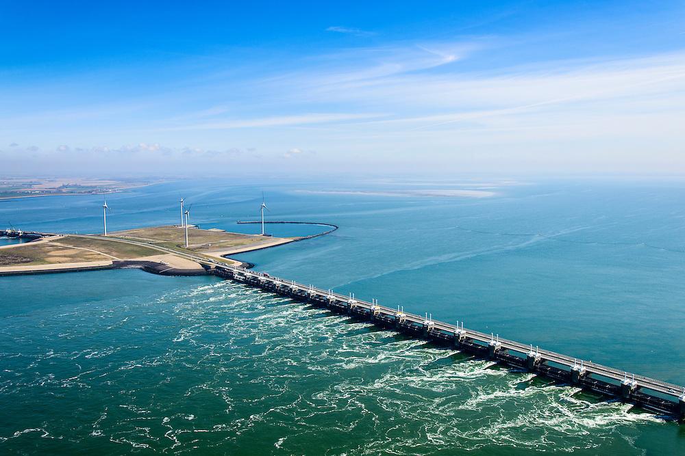 Nederland, Zeeland, Gemeente Schouwen-Duiveland, 01-04-2016; stormvloedkering Oosterschelde (Oosterscheldekering) gezien naar Roggenplaat. Het is eb en het water stroomt van de Oosterschelde naar de Noordzee door het sluitgat Schaar.<br /> Eastern Scheldt storm surge barrier (Oosterscheldekering). It is low tide and the water flows from the Eastern Scheldt to the North Sea.<br /> <br /> luchtfoto (toeslag op standard tarieven);<br /> aerial photo (additional fee required);<br /> copyright foto/photo Siebe Swart