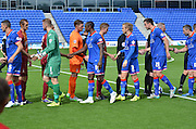 the teams greet each other before kick off during the Sky Bet League 1 match between Oldham Athletic and Bradford City at Boundary Park, Oldham, England on 5 September 2015. Photo by Mark Pollitt.