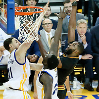 04 June 2017: Cleveland Cavaliers center Tristan Thompson (13) goes for the sky hook over Golden State Warriors forward Draymond Green (23) and Golden State Warriors guard Klay Thompson (11) during the Golden State Warriors 132-113 victory over the Cleveland Cavaliers, in game 2 of the 2017 NBA Finals, at the Oracle Arena, Oakland, California, USA.