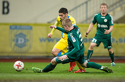 Matija Sirok of NK Domzale vs Patrik Horzen of Krka during football match between NK Domzale and NK Krka in Semifinal of Slovenian Football Cup 2016/17, on April 4, 2017 in Sports park Domzale, Slovenia. Photo by Vid Ponikvar / Sportida