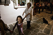Supporters of their Mayor George Poussaios dance during his reelection celebration at the town on the island of Ios, Greece on October 11, 2002. Poussaios has been the mayor of the island of Ios since 1990. Photo by Jakub Mosur