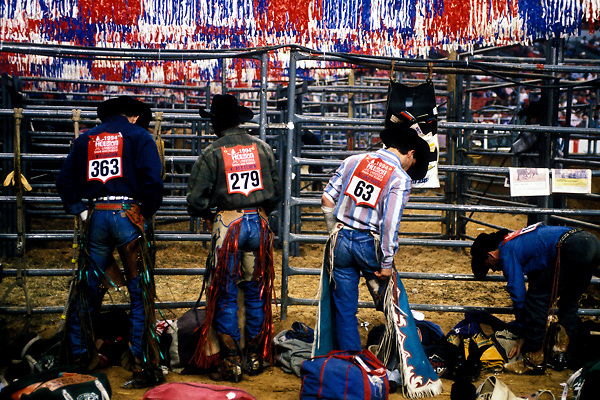 Cowboys preparing for rodeo events at the Houston Livestock Show and Rodeo