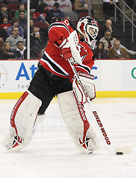 Mar 15; Newark, NJ, USA; New Jersey Devils goalie Martin Brodeur (30) plays the puck during the third period of their game against the Colorado Avalanche at the Prudential Center. The Devils defeated the Avalanche 1-0.