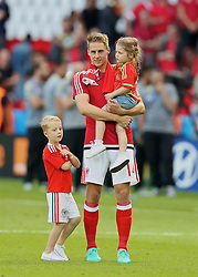 PARIS, FRANCE - Saturday, June 25, 2016: Wales' David Edwards and his children after the 1-0 victory over Northern Ireland during the Round of 16 UEFA Euro 2016 Championship match at the Parc des Princes. (Pic by David Rawcliffe/Propaganda)
