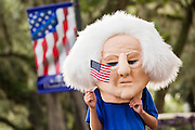 A child wearing a George Washington head watches the Daniel Island Independence Day parade July 3, 2015 in Charleston, South Carolina.