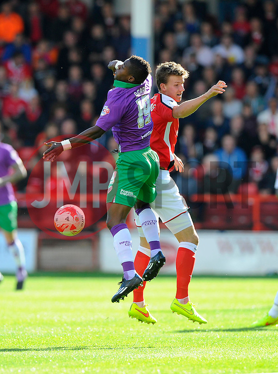 Bristol City's Kieran Agard battles for the high ball with Walsall's Paul Downing  - Photo mandatory by-line: Joe Meredith/JMP - Mobile: 07966 386802 - 04/10/2014 - SPORT - Football - Walsall - Bescot Stadium - Walsall v Bristol City - Sky Bet League One