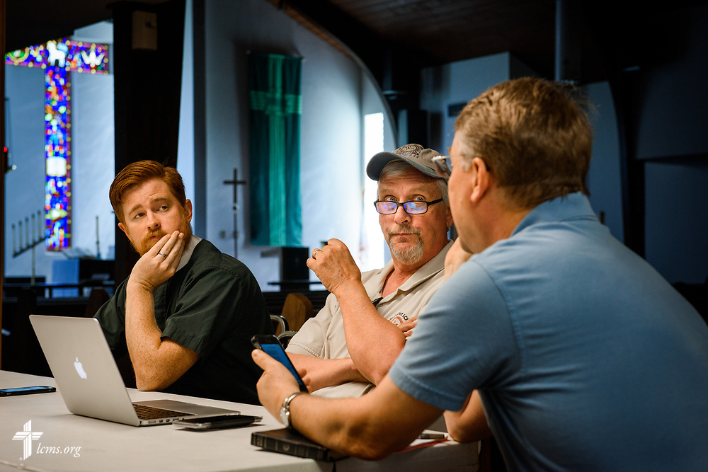 The Rev. Dustin Beck, pastor of Trinity Lutheran Church, Corpus Christi, Texas, and the Rev. Steve Misch, disaster relief coordinator for the LCMS Texas District, listen to the Rev. Dr. Richard Lofgren, pastor of Our Savior Lutheran Church, Corpus Christi, during a meeting together following Hurricane Harvey on Thursday, Aug. 31, 2017, at Mount Olive Lutheran Church, Corpus Christi,  Texas. LCMS Communications/Erik M. Lunsford