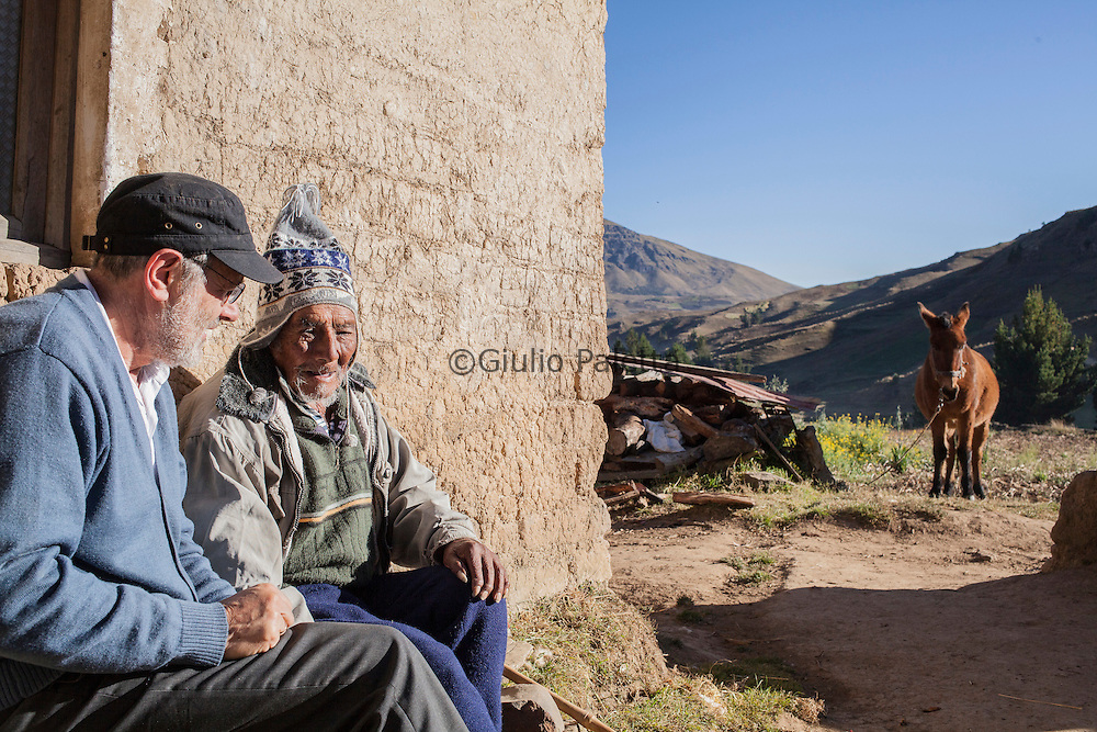 Italian doctor Pietro Gamba with his patient in Challviri, near Cochabamba, in the Bolivian Andes