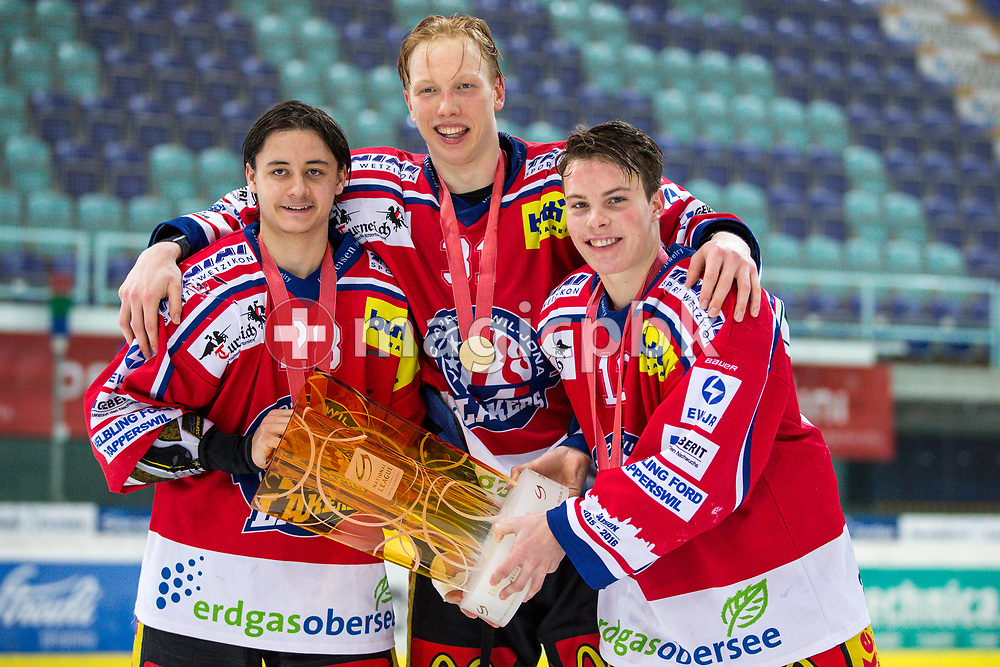 (L-R) Rapperswil-Jona Lakers forward Siro Rutzer, Ryhor Ustsimenka and Nicola Meier pose for a photo with their gold medals and the Swiss Champion trophy after winning the fifth Elite B Playoff Final ice hockey game between Rapperswil-Jona Lakers and ZSC Lions held at the SGKB Arena in Rapperswil, Switzerland, Sunday, Mar. 19, 2017. (Photo by Patrick B. Kraemer / MAGICPBK)