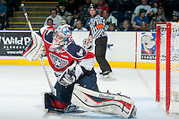 KELOWNA, CANADA - MARCH 23: Eric Comrie #1 of the Tri-City Americans makes a save against the Kelowna Rockets on March 23, 2014 at Prospera Place in Kelowna, British Columbia, Canada.   (Photo by Marissa Baecker/Shoot the Breeze)  *** Local Caption *** Eric Comrie;
