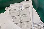Documents lay in a trash bin outside a meeting at the EU Council.