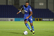 AFC Wimbledon midfielder Liam Trotter (14) dribbling during the EFL Trophy group stage match between AFC Wimbledon and U21 Swansea City at the Cherry Red Records Stadium, Kingston, England on 18 September 2018.