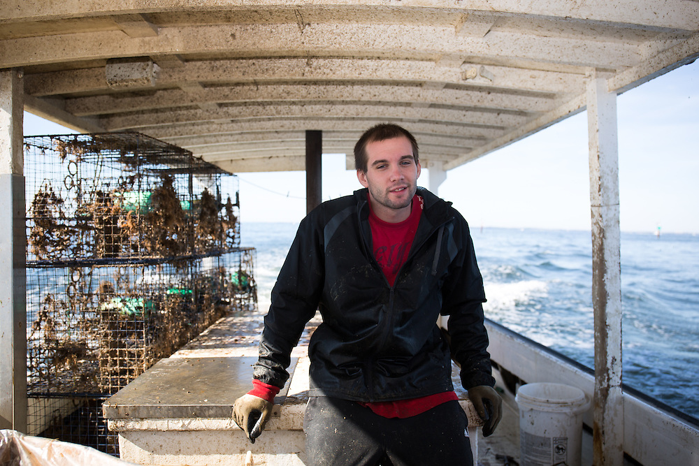 Chris Shipley patiently waits to drop the crab traps into a new location in the Chesapeake Bay | October 11, 2015| October 11, 2015