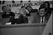 Fianna Fáil Ard Fheis.  (R97)..1989..25.02.1989..02.25.1989..25th February 1989..The Fianna Fáil Ard Fheis was held today at the RDS Main Hall, Ballsbridge, Dublin. An Taoiseach, Charles Haughey TD,gave the keynote speech of the event...Ministers John Wilson TD and Ray Burke TD are pictured listening to the delegate speeches.