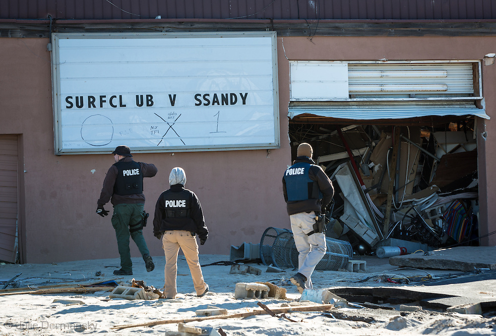Ortley Beach, New Jersay, November 3, 2012,  Police walk  behind a popluar bar where the boardwalk used to be in  a destroyed neighborhood after Hurricane Sandy's surge flooded the entire barrier island. The Jersey shore took the brunt of Hurricane Sandy.
