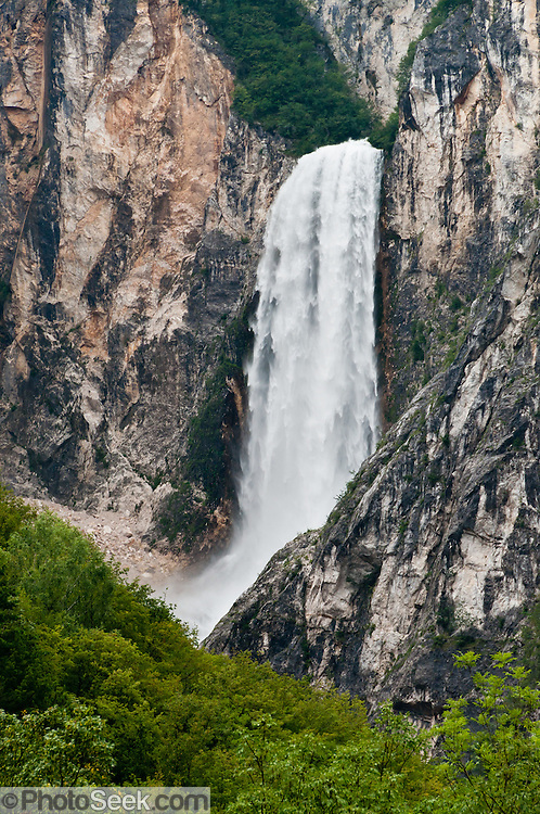 Boka waterfall (Slap Boka) plunges freely 106 meters plus another 30-meter cascade below. View from the road between Zaga and Bovec, Slovenia, Europe.