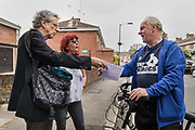 London, England, UK, May 31 2018 - Housing activists Piers Corbyn (left) and Aysen Dennis (middle) chatting with a local resident near Aylesbury Estate,  a housing estate in Walworth, South East London. <br /> Aylesbury  estate, once the largest estate in Europe, is currently undergoing a major regeneration programme by demolishing and replacing of the dwellings with modern houses controlled by a housing association. Some residents and activists still protest against the demolition and the gentrification of London.<br /> London is facing a major housing crisis, due to rising cost and under-supply.