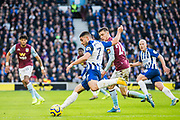 Neal Maupay (Brighton) attempt at goal with Frederic Guilbert (Aston Villa) close by during the Premier League match between Brighton and Hove Albion and Aston Villa at the American Express Community Stadium, Brighton and Hove, England on 18 January 2020.