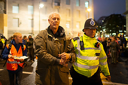 © Licensed to London News Pictures. 07/10/2019. London, UK. Extinction Rebellion protesters are led away by police on Lambeth Bridge . Photo credit: George Cracknell Wright/LNP