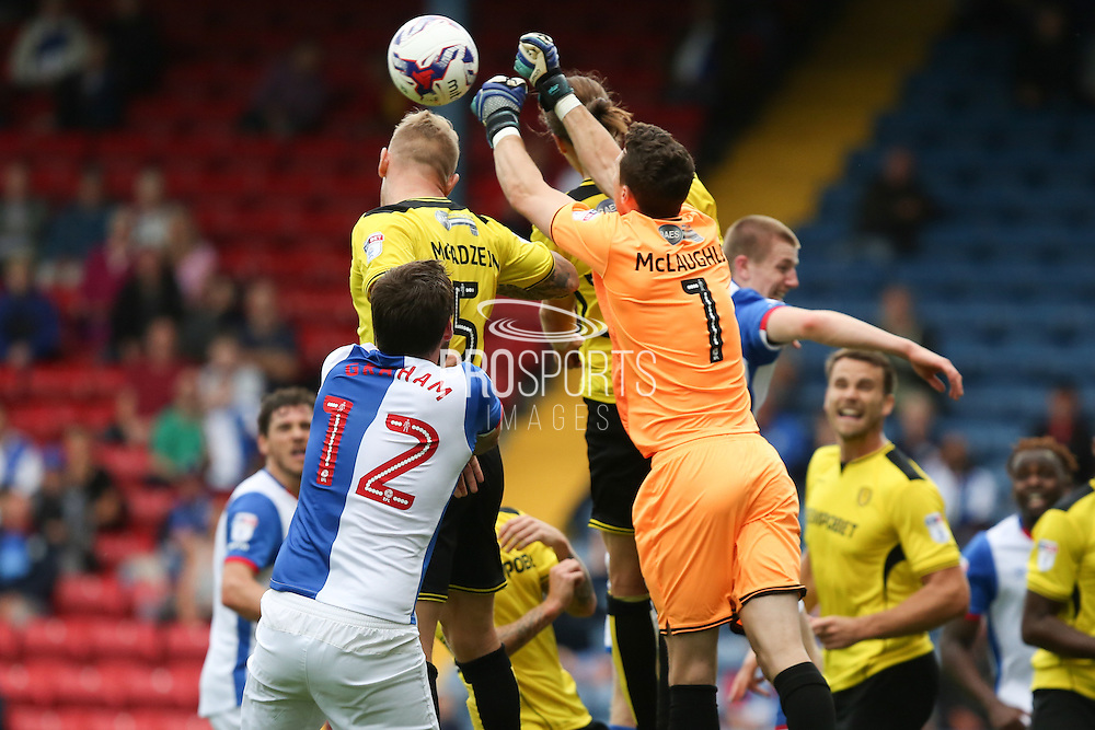 Jon McLaughlin of Burton Albion punches the ball clear from a cross under pressure from Danny Graham of Blackburn Rovers during the EFL Sky Bet Championship match between Blackburn Rovers and Burton Albion at Ewood Park, Blackburn, England on 20 August 2016. Photo by Simon Brady.