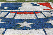 ANAHEIM, CA - APRIL 07:  The MLB opening series logo is painted on the field grass for the Los Angeles Angels of Anaheim game against the Kansas City Royals on Saturday, April 7, 2012 at Angel Stadium in Anaheim, California. The Royals won the game 6-3. (Photo by Paul Spinelli/MLB Photos via Getty Images)