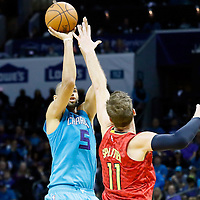 01 November 2015: Charlotte Hornets forward Nicolas Batum (5) takes a jump shot over Atlanta Hawks forward Tiago Splitter (11) during the Atlanta Hawks 94-92 victory over the Charlotte Hornets, at the Time Warner Cable Arena, in Charlotte, North Carolina, USA.