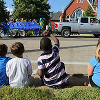 Childredn from CASA wave to passing floats during Thursday's annual Tupelo Public School Distict's Homecoming Parade along Main Street.