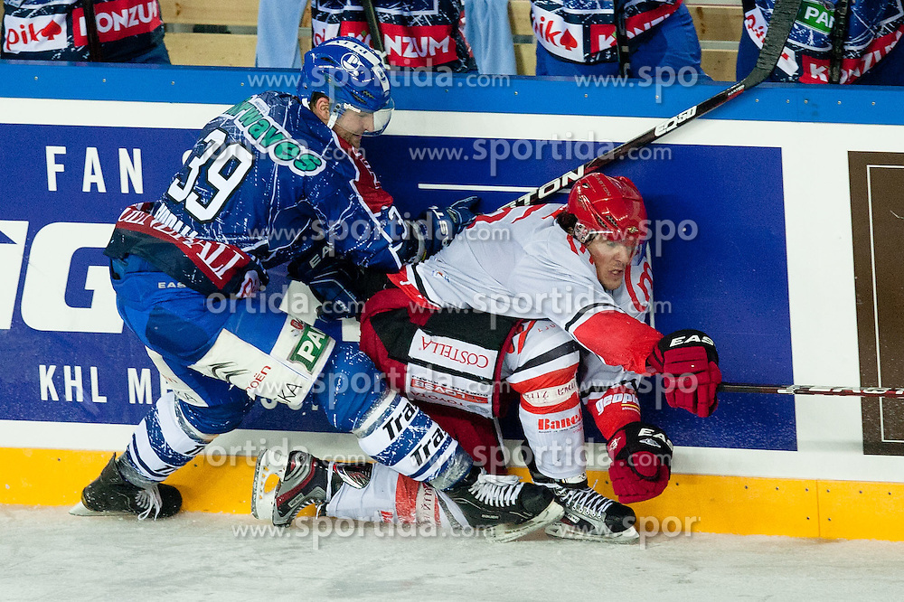 Matt Siddall (KHL Medvescak Zagreb, #39) vs Jaka Ankerst (HK Acroni Jesenice, #26) during ice-hockey match between KHL Medvescak Zagreb and HK Acroni Jesenice in 39th Round of EBEL league, on Januar 8, 2012 at Arena Zagreb, Zagreb, Croatia. (Photo By Matic Klansek Velej / Sportida)