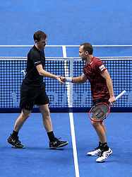 Great Britain's Jamie Murray (left) and Brazil's Bruno Soares (right) celebrate taking a point during day five of the Barclays ATP World Tour Finals at The O2, London.