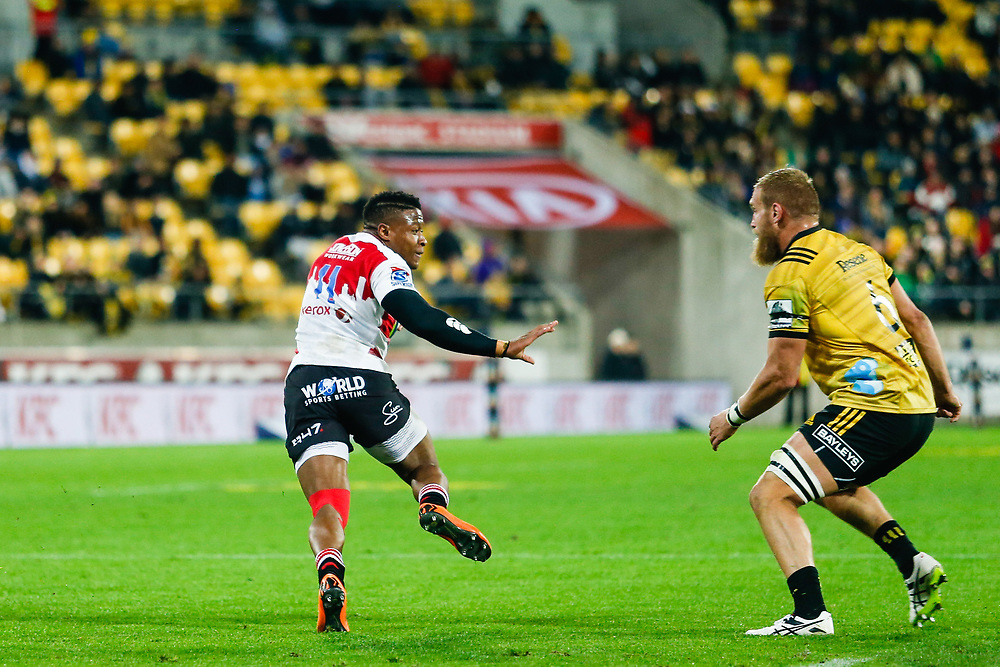 Aphiwe Dyantyi fends-off Brad Shields (captain) during the Super rugby (Round 12) match played between Hurricanes  v Lions, at Westpac Stadium, Wellington, New Zealand, on 5 May 2018.  Hurricanes won 28-19.