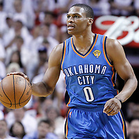 19 June 2012: Oklahoma City Thunder point guard Russell Westbrook (0) brings the ball upcourt during the first quarter of Game 4 of the 2012 NBA Finals, Thunder at Heat, at the AmericanAirlinesArena, Miami, Florida, USA.