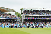 The New Zealand and England teams walk out for the national anthems ahead of the ICC Cricket World Cup 2019 Final match between New Zealand and England at Lord's Cricket Ground, St John's Wood, United Kingdom on 14 July 2019.