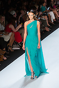 Sea green one-shoulder dress with a high slit side. By Monique Lhuillier at Spring 2013 Fall Fashion Week in New York.